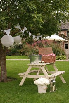 Bury Court Barn Surrey - Vintage-style picnic bench, white bunting, white paper lanterns, cream parasol, Fortnum and Mason picnic hamper, chequered picnic rug, cream bucket and hexagonal lantern by www.stressfreehire.com #venuetransformers