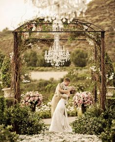 beautiful altar decorated in flowers and vines for an outside wedding, chandelier by dukek Wedding Ceremony Ideas, Outdoor Ceremony, Wedding Trends, Outdoor Weddings, Ceremony Arch, Wedding Arches, Wedding Gazebo, Rustic Wedding, Chic Wedding