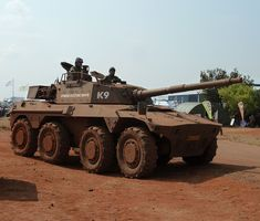 Two versions exist. The Rooikat 76 armoured fighting vehicle, with a gun. Rooikat In 1990 an upgrade and redesign programe, & by 1994 the development of the Rooikat 105 variant with a rifled gun was completed. Army Vehicles, Armored Vehicles, South African Air Force, Military Armor, Defence Force, Armored Fighting Vehicle, Battle Tank, Military Equipment, Modern Warfare