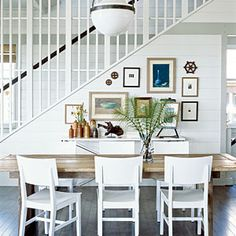 Tim Clarke Lookbook | Open Plan | CoastalLiving.com\ great pictures on the wall by the stairs