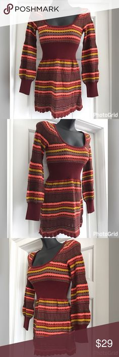 """💜 Free People Long Sleeve Sweater Mini Dress XS Free People Sweater Mini dress.  Long sleeves.  Striped. Scoop neck.  Pullover style.  Length approximately 28"""".  Size XS.  Maroon color with orange, pink stripes.  Empire waist.  It is used but in good condition.  See close up pictures for wear.  Small piling on waist area nothing major.  Please ask any questions. Free People Dresses Mini"""