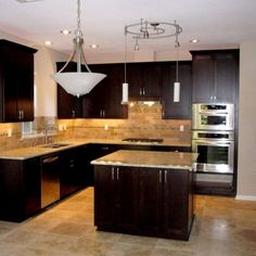 Beautiful kitchen remodel. Love the dark wood and stainless appliances!