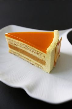 Gourmet Baking: Exotic Orange Cake - An orange vanilla bavaroise, a vanilla cremeux, a honey cake layer, a passion fruit gelee, and a white chocolate spray. Gourmet Desserts, Fancy Desserts, Just Desserts, Delicious Desserts, Gourmet Cakes, Sweet Recipes, Cake Recipes, Dessert Recipes, Gourmet Festival