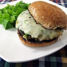 Spinach Stuffed Mushroom Burger « This marinated grilled portabella mushroom burger is stuffed with a deliciously buttery spinach filling and topped with melted cheese. You'll love how easy these are to prepare, and you'll be even more impressed with the complexity of their flavor – all thanks to an easy marinade that uses ingredients you probably already have laying around the house.