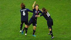 Japan celebrate scoring opening goal  Footballer Yuki Ogimi of Japan celebrates with team mates Mizuho Sakaguchi and Homare Sawaduring the women's quarter-final match against Brazil.  /Photo/sport/General/01/32/26/921japan-celebrates-scoring-opening-goal1322692  Related tags