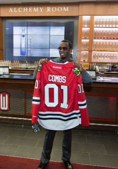 """""""It's all about the #Blackhawks, baby."""" Diddy shows off his new Hawks jersey!"""