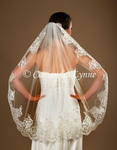 A dramatic 8 inch wide lace creates a luxurious style for this 36 inch bridal veil. It is 36 inches long and 72 inches wide, on a three inch metal comb. Made in the USA! This veil can be customized! H