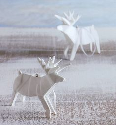 Origami Reindeer Modern Christmas Ornaments. I would likely fail so hard at attempting to make these, but they are really pretty.