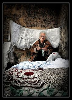 Craft Stall Photo by David Merrilees I took this picture in an old town in the south of Portugal this year, and as I got to speaking with her, she told me that she has been doing this for well over 40 years. Algarve, Portuguese Culture, Craft Stalls, Spain And Portugal, Portugal Travel, Azores, People Of The World, Life Is Beautiful, Around The Worlds