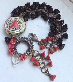 Red and black heart bracelet flower cluster  by ButtonedUpBeads