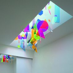 first week of camp students make shapes with plastic and tissue paper (hang from ceiling)