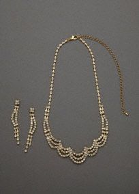 """This elegant necklace and earring set is beautifully embellished with crystals. The scallop design of the necklace allows it to lay beautifully and complement any neckline.  This gorgeous set is sure to make you look like you stepped right off the red carpet glamour.  Crystal necklace features beautifully embellished scallop design.  Linear dangle post earrings finish off the look.  Necklace measures 8 1/2"""" long + 3"""" extender. Earrings measure 2 1/2"""" long.  Imported."""