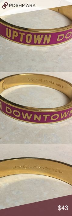 """Kate Spade UPTOWN DOWNTOWN Idiom Bangle Kate Spade Hinge Idiom Bangle, hot pink with """"Uptown Downtown"""" in block gold lettering. Inside engraving has Kate Spade New York on one side, and """"Go the Extra Mile"""" on the other! Great condition! Happy shopping! 🦄🦄 kate spade Jewelry Bracelets"""