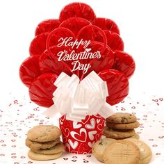 """This bouquet says it best! Twelve """"made from scratch"""" gourmet cookies, wrapped in red cello, are tastefully arranged in a heart design melamine pot along with a 5"""" pick stating """"Happy Valentine's Day"""".  Cookie assortment includes: chocolate chip, oatmeal raisin, sugar, peanut butter, M&M, white chocolate chip pecan"""