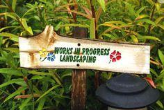 Image from http://www.donthelaserman.com/garden_signs_landscaping.jpg.