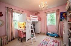 Cute girls' bedroom in pink with a loft bed that comes with storage space and a work table - Decoist