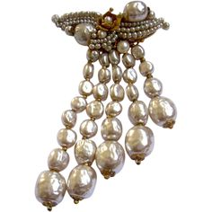 Treat yourself to a luxurious cascade of lustrous baroque pearls, courtesy of Miriam Haskell. Via this drippy floral brooch showcasing the best of  $360