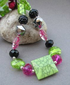 Chunky beaded necklace in black, hot pink, and lime green