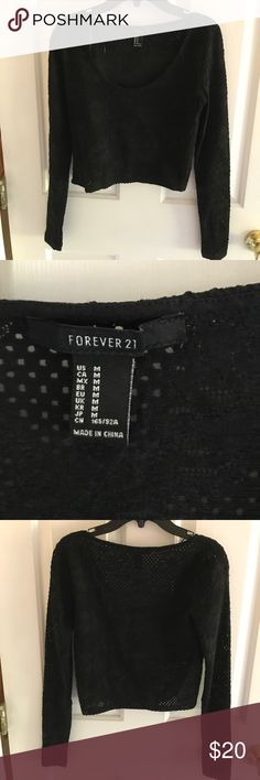 Forever 21 Black Lace Crop Long sleeve Lacey black crop top. Perfect with skirts, high waisted pants or just about anything! Super cute Forever 21 Tops Crop Tops