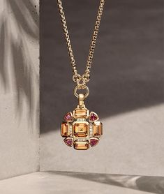 Jewelry OFF! David Yurman: A David Yurman Novella pendant in yellow gold with madeira citrine pink tourmaline and white diamonds hanging on an gold chain necklace in front of a sandy-colored stone with long shadows of leaves. Stone Necklace, Stone Jewelry, Diamond Jewelry, Gold Necklace, Diamond Pendant, Necklace Set, Pendant Necklace, Amber Jewelry, Gold Jewelry