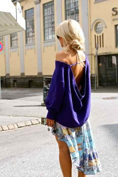 oversized, draped sweater.