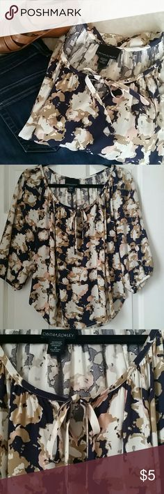 Cynthia Rowley Blouse Cynthia Rowley blouse in navy, tan, white, and pink. Has a scoop neck with ties. Pairs nicely with dark or white jeans. Made of 100% rayon. Very soft. One snag as seen in fourth picture. Cynthia Rowley Tops Blouses