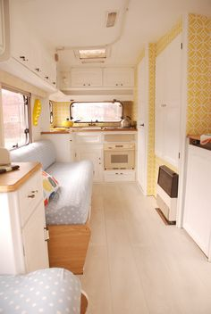 N2S - I like this look for my caravan makeover, the yellow and white is clean, and faded denim blue on the squabs looks casual and fresh. Will add white and pink/purple/yellow granny square quilts and a honey-coloured pine floor. Overhead cupboards in brown formica can stay.
