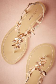 Chrysanthe Sandals from @BHLDN.  Grecian gold sandals for the boho brides.  Bohemian brass flowers accented with crystals.