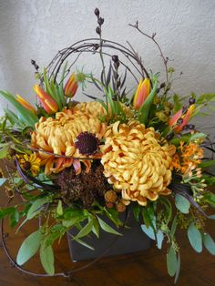 Fall arrangement with football mums and tulips