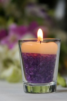 Shot glass + purple rocks + tealight candle = table decoration