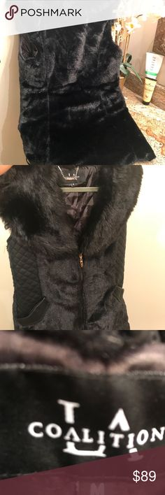 Coalition long faux fur vest New black Coalition faux fur vest. Hip length. Mint condition. Never been worn. Gorgeous! Coalition LA Jackets & Coats Vests