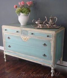 This beautiful buffet was finished in a soothing combination of Duck Egg Blue & Old Ochre Chalk Paint® decorative paint by Annie Sloan | By The Newest of Old http://thenewestofold.com/