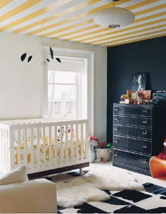 Add interest on the ceiling (where a child's imagination can run wild) and a wall of black chalkboard paint   domino.com
