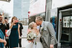 Wedding photography in front of wedding bus, city vibes