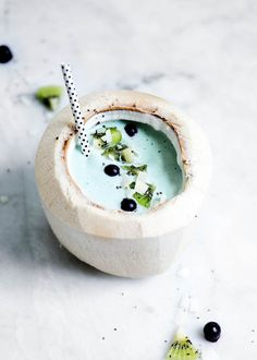 A blue algae smoothie filled with detoxifying spirulina, chia seeds, and blueberries. Hello, summer bod.