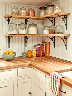 vintage kitchen Pieces of chestnut, reclaimed from a barn in nearby Chester County, make the corner open shelves extra eye-catching. Home Decor Kitchen, Kitchen Furniture, Diy Kitchen, Kitchen Interior, Home Kitchens, Kitchen Dining, Kitchen Cabinets, County Kitchen Ideas, Corner Shelves Kitchen