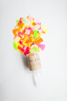 Photography: Cambria Grace Photography  Read More: http://www.stylemepretty.com/2014/05/12/diy-push-pop-confetti/
