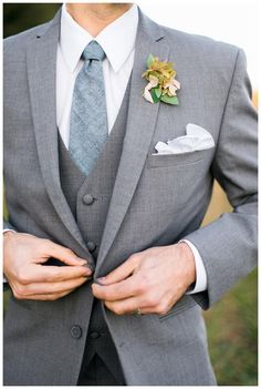 Groom style: 3-piece gray suit with woven slate blue tie from The Modern Gent. Boutonnière by Mary McLeod for Amy Osaba Events, image by Rustic White Photography. Women, Men and Kids Outfit Ideas on our website at 7ootd.com #ootd #7ootd