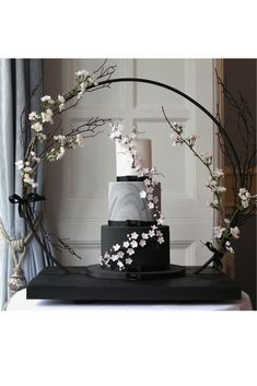 Modern black and marble wedding cake with sugar cherry blossoms. Made by Debbie Gillespie Cake Design, supplying wedding cakes to Yorkshire, Cheshire and Manchester black wedding cakes Cherry blossom wedding cake Wedding Cake Display, Luxury Wedding Cake, Black Wedding Cakes, Wedding Cake Stands, Elegant Wedding Cakes, Elegant Cakes, Beautiful Wedding Cakes, Wedding Cake Designs, Modern Wedding Decorations