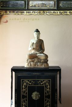 Antique Buddha statue from Burma sculpted from teak wood and painted.