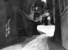 Silent Film Photography: The Cabinet of Dr Caligari, 1920 Lil Dagover cowers on possibly the most recognisable set in film history – the nightmare landscape of Robert Wiene's The Cabinet of Dr Caligari. Hermann Warm's boldly expressionist designs for the film, with their tipsy angles and long shadows, encapsulate its twisting plot and air of paranoia. Cinematographer Willy Hameister's camera tilts downwards, an unsettling angle that further exaggerates the effect