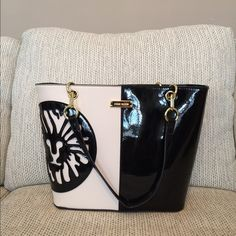 Anne Klein Double Trouble Tote Large tote in cream and black patent leather, gold hardware. Plenty of pockets and a middle zipper pocket divider. NWT Anne Klein Bags Totes
