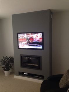 Riva studio balance flue fire with Panasonic tv above.