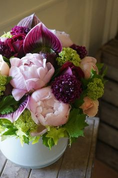 Beautiful bouquet of flowers. Love the peonies  violets especially.