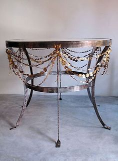 Accessorize a normal furniture piece like this table to glam it up!