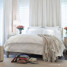 Bedroom decor ideas - all white bed, full height curtains, neutral decor, light and bright room with simple style.