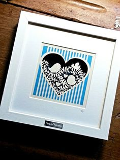 Squeeeee!! Bird is going to be a Daddy :) A cute little papercut, hand drawn and hand cut from a piece of cream paper with a blue front layer and dark blue backing.Double glass and double mount give this piece a layered, three dimensional effect and casts pretty shadows in the right light. Handmade white wood frame, finished with engraved Paper Panda plaque. 25x25cmDue to damage on the bottom left side of the frame (you probably wouldn't notice, but see picture) this ite...