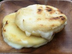 Arepa con Queso (cheese stuffed corn cakes). Had these at Latino Fest--must make!!!