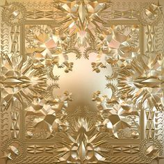 Hip hop album cover for Kanye West and Jay-zs album Watch the Throne. It is gold with engraved and embossed patterns on it.