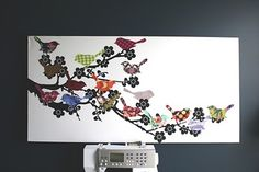 A  large wall art piece that uses all the little pieces of fabric up...great way to unify a room too!!